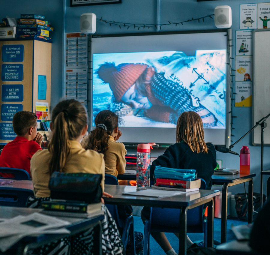 Children watching the Melva feature film in a classroom