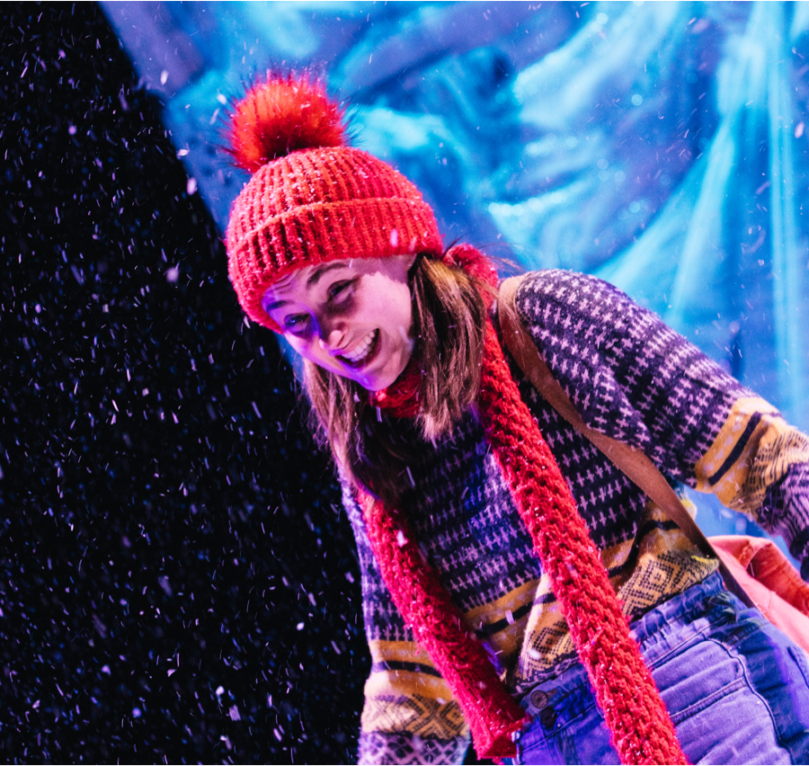 The character of Melva performing in the live show with snow falling a grimace on her face