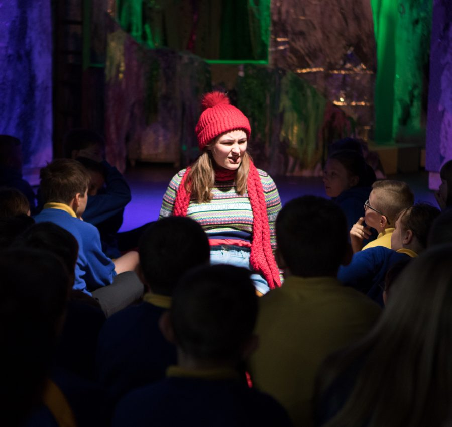 Melva, in the live Melva show, surrounded by school children